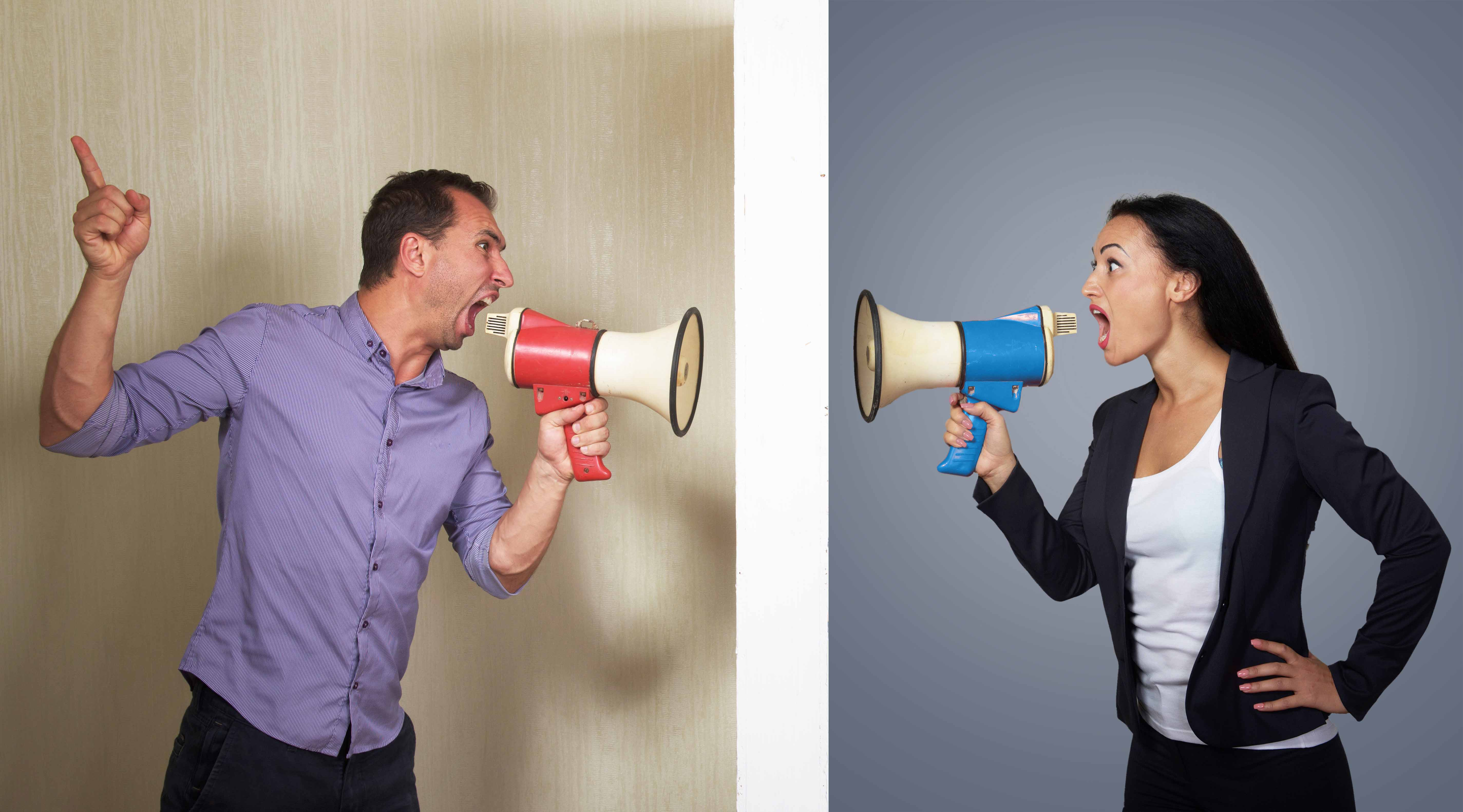 Man and woman shouting in megaphones at each other
